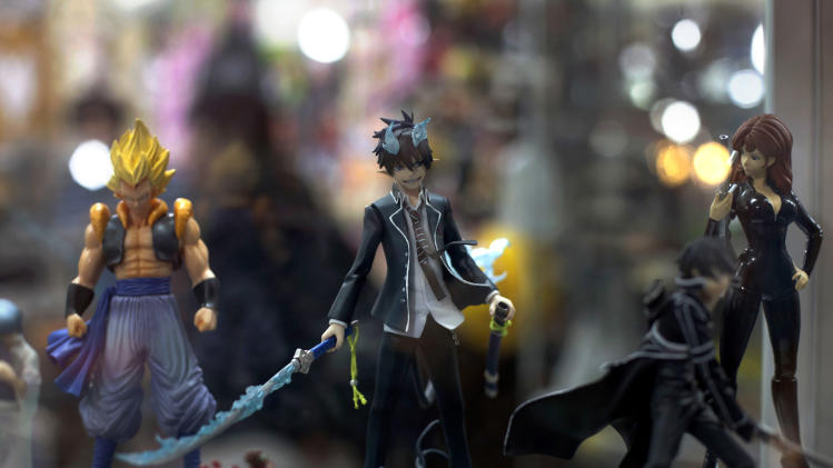 In this May 25, 2013 photo, figures of South Korean comic book characters stand for sale at the Arenales shopping center in Lima, Peru. The Arenales shopping center has entire floors dedicated to South Korean music, clothes and food. (AP Photo/Martin Mejia)