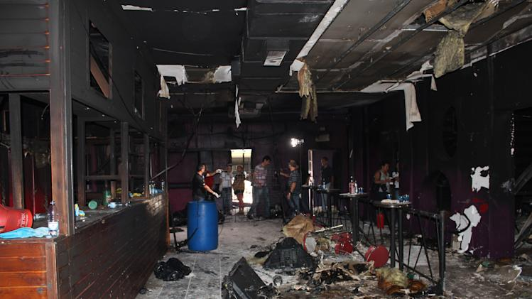 This photo released by Policia Civil do Rio Grande do Sul, shows the inside of the Kiss nightclub  where a fire killed more than 230 people in Santa Maria city, Rio Grande do Sul state, Brazil, Tuesday, Jan. 29, 2012. The blaze began at around 2:30 am local time on Sunday, during a performance by Gurizada Fandangueira, a country music band that had made the use of pyrotechnics a trademark of their shows. (AP Photo/Policia Civil do Rio Grande do Sul)