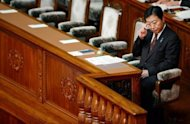 Japanese Prime Minister Yoshihiko Noda sits in his seat at parliament in Tokyo on August 24. Japan&#39;s opposition was set Wednesday to file a censure motion against Noda that threatens to stall parliament and bolster calls for snap elections