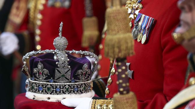 The Imperial State Crown is ceremonially carried into the Palace of Westminster for the State Opening of Parliament in central London