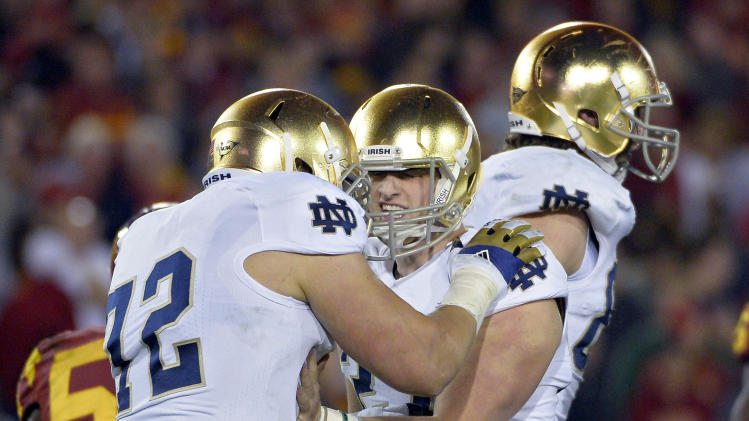 Notre Dame kicker Kyle Brindza, center, celebrates with offensive tackle Nick Martin after kicking a field goal during the second half of an NCAA college football game against Southern California, Saturday, Nov. 24, 2012, in Los Angeles. Notre Dame won 22-13. (AP Photo/Mark J. Terrill)