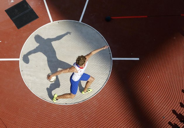 France's Kevin Mayer competes in the men's decathlon discus throw event at the London 2012 Olympic Games at the Olympic Stadium