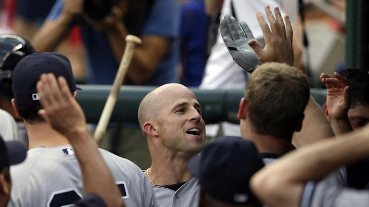 New York Yankees' Brett Gardner, center, celebrates with teammates after hitting a solo home run off of Texas Rangers starting pitcher Yu Darvish in the third inning of a baseball game, Monday, July 28, 2014, in Arlington, Texas. (AP Photo/Tony Gutierrez)