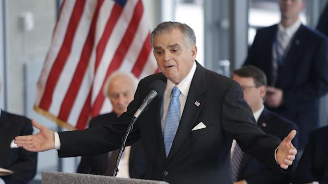 U.S. Transportation Secretary Ray LaHood announces during a news conference in Detroit, Friday, Jan. 18, 2013 that the federal government will award $25 million toward the $140-million M-1 Rail project. The 3.3-mile streetcar line along Woodward Avenue will link the city's downtown and the cultural, medical and educational center a few miles north. (AP Photo/Carlos Osorio)