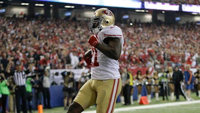 San Francisco 49ers' Frank Gore breaks away for a five-yard touchdown run during the second half of the NFL football NFC Championship game against the Atlanta Falcons Sunday, Jan. 20, 2013, in Atlanta. (AP Photo/Mark Humphrey)