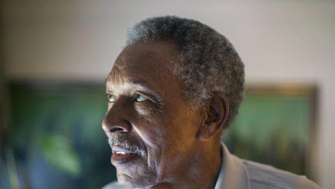 In this June 20, 2013 photo, Otis McDonald, 79, looks out the window of his home on Chicago's South Side. McDonald, who was the lead plaintiff in the lawsuit that led the U.S. Supreme Court to overturn the Chicago's handgun ban has died. McDonald's death on Friday, April 4, 2014, was confirmed Sunday by his nephew and family spokesman, Fred Jones. McDonald was one of four plaintiffs who challenged the city's decades-old handgun ban and who won a 5-4 decision in 2010. He argued that he was trying to protect himself and his family from the violence outside his front door in a deteriorating neighborhood on Chicago's South Side. (AP Photo/Scott Eisen)