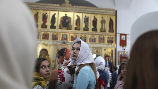 People attend a mass led by Patriarch Kirill, the head of the Russian Orthodox Church, at the Russian Orthodox church in Havana