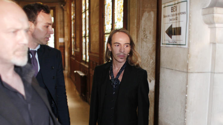 Former Dior designer John Galliano arrives at the Paris court house, Wesdnesday June 22, 2011, charged with hurling anti-Semitic slurs in a Paris cafe - allegations that shocked the fashion world and cost him his job at the renowned French high-fashion house. Galliano could face up to six months in prison and 22,500 euro ($32,175) in fines. The verdict is expected at a later date.(AP Photo/Thibault Camus)