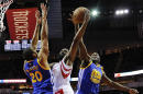 Golden State Warriors forward Draymond Green (23) blocks the shot of Houston Rockets guard James Harden, center, as forward James Michael McAdooin defends during the first half of an NBA basketball game, Friday, Jan. 20, 2017, in Houston. (AP Photo/Eric Christian Smith)