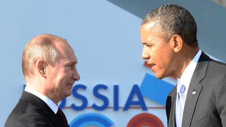 Vladimir Putin (L) welcomes Barack Obama at the start of the G20 summit in Saint Petersburg on September 5, 2013