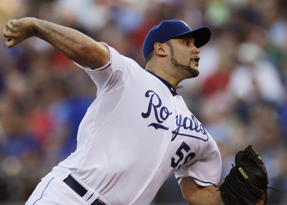 Kansas City Royals starting pitcher Felipe Paulino (59) pitches to Boston Red Sox's Josh Reddick during the second inning of a baseball game in Kansas City, Mo., Saturday, Aug. 20, 2011. (AP Photo/Orlin Wagner)