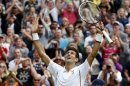 Novak Djokovic of Serbia celebrates after defeating Jeremy Chardy of France in their men's singles tennis match at the Wimbledon Tennis Championships, in London