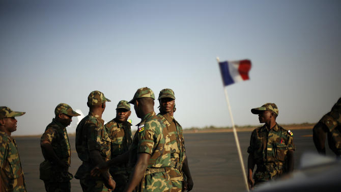 West African soldiers from Togo arrive at Bamako's airport Thursday Jan. 17, 2013. They were the first contingent of West African troops brought to Mali to help French and government forces  fight jihadist insurgents in control of the north of the country. Fighting raged in one Mali town, airstrikes hit another and army troops raced to protect a third, on the seventh day of the French-led military intervention to wrest back Mali's north from al Qaida-linked groups. (AP Photo/Jerome Delay)