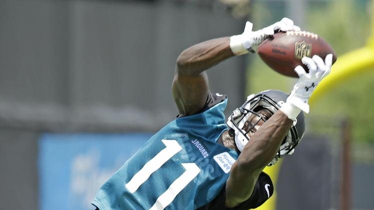 Jacksonville Jaguars receiver Marqise Lee catches a pass during an NFL organized team activities football practice in Jacksonville, Fla., Tuesday, May 27, 2014