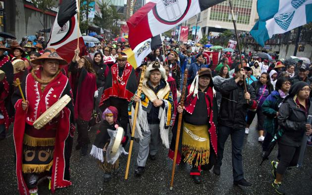 First Nations' people in traditional dress take part in a Truth and Reconciliation march in Vancouver