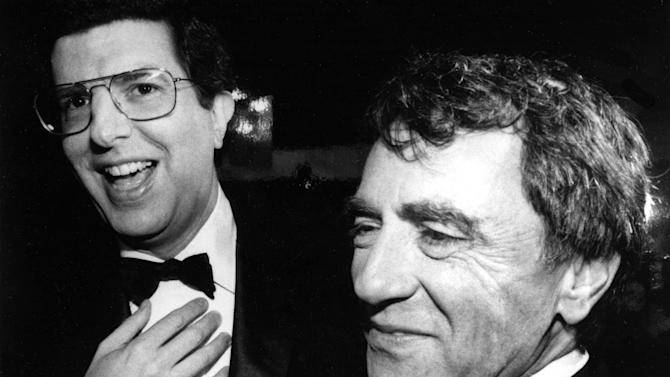 "FILE - This Oct. 12, 1983 file photo shows composer Marvin Hamlisch, left, and theatrical producer Joseph Papp at the record-breaking 3,389th performance of the musical ""A Chorus Line,"" in New York. Hamlisch, a conductor and award-winning composer best known for the torch song ""The Way We Were,"" died Monday, Aug. 6, 2012 in Los Angeles. He was 68. (AP Photo, file)"