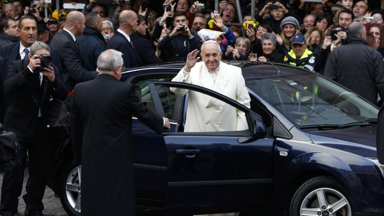 Pope Francis waves as he arrives for the Immaculate Conception celebration prayer in Piazza di Spagna in downtown Rome