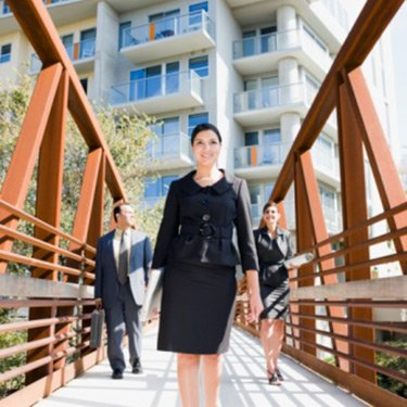 Businesspeople-walking-across-bridge_web