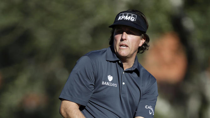 Phil Mickelson reacts after missing a birdie putt on the second hole during the first round of the Humana Challenge golf tournament at the La Quinta Country Club in La Quinta, Calif., Thursday, Jan. 17, 2013. (AP Photo/Chris Carlson)