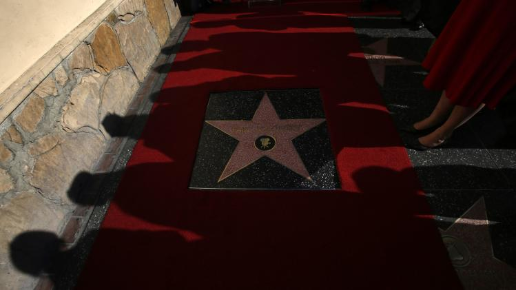 People look at actor Paul Mazursky's star on the Walk of Fame in Hollywood
