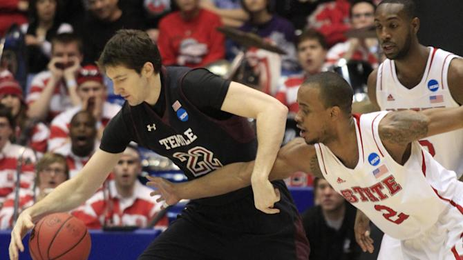 North Carolina State guard Lorenzo Brown (2) reaches in on Temple forward Jake O'Brien (22) during the first half of a second-round game at the NCAA college basketball tournament, Friday, March 22, 2013, in Dayton, Ohio. (AP Photo/Al Behrman)