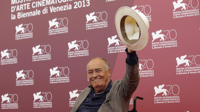 Jury president Bernardo Bertolucci poses for photographers at the Jury photo call during the 70th edition of the Venice Film Festival held from Aug. 28 through Sept. 7, in Venice, Italy, Wednesday, Aug. 28, 2013. (AP Photo/Andrew Medichini)
