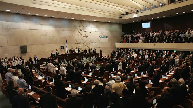 FILE - In this Sunday, July 15, 2007 file photo, a general view of the Knesset, Israel's parliament, is seen during the inauguration of Israel's newly elected President Shimon Peres at a ceremony in Jerusalem. Israel's prime minister held the prospect of early elections over the heads of his coalition partners Tuesday, opening a drive to get his budget approved, a campaign that could have foreign policy implications.(AP Photo/David Silverman, Pool, File)