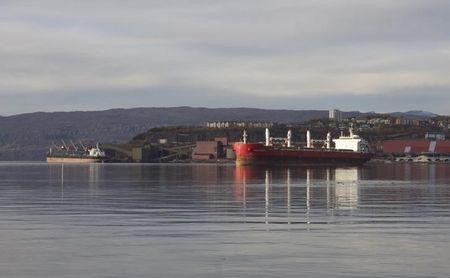 A ship loading iron ore manoeuvres in the Norwegian Arctic port of Narvik