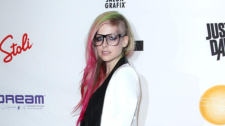 This image released by Starpix shows Avril Lavigne at the showing of her Abbey Dawn by Avril Lavigne Spring 2013 collection, Monday, Sept. 10, 2012, during Fashion Week in New York. (AP Photo/Starpix, Kristina Bumphrey)