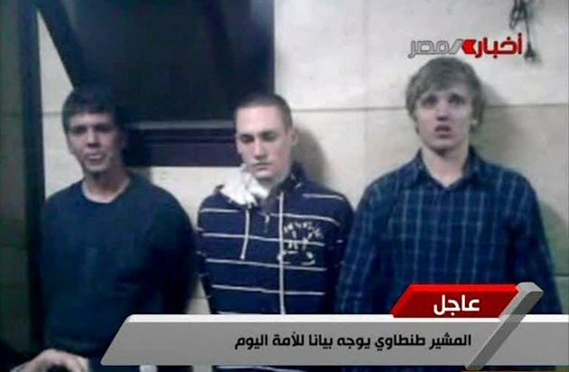 FILE - In this Tuesday, Nov. 22, 2011 file image from Egyptian state television, three American students are displayed to the camera by Egyptian authorities following their arrest during protests in Cairo, where an Egyptian official said they were throwing firebombs at security forces. A spokeswoman for the American University in Cairo identified the students as Luke Gates, a 21-year-old Indiana University student from Bloomington, Ind.; Derrik Sweeney, a 19-year-old Georgetown University student from Jefferson City, Mo.; and Gregory Porter, a 19 year-old Drexel University student from Glenside, Pa. An official says an Egyptian court has ordered release of 3 US students arrested during Cairo unrest.(AP Photo/ Egyptian TV, File)
