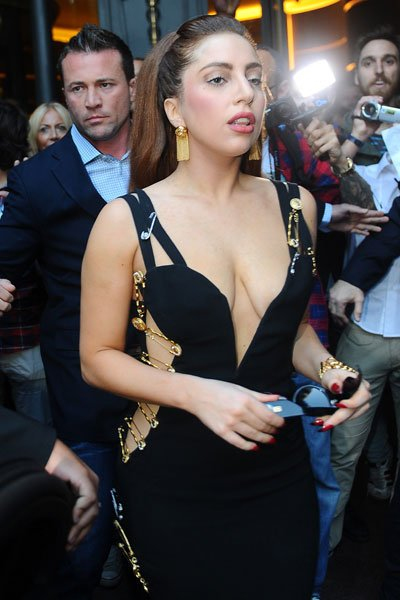 Despite getting criticism for her recent weight gain, Lady Gaga looks the picture of health while out and about in Milan. The controversial singer stepped back in time in an iconic safety pin Versace