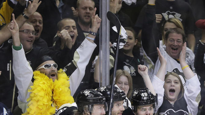 Pittsburgh Penguins' Kris Letang, center, celebrates with teammates Jussi Jokinen, left, and Tyler Kennedy after his goal during the second period in Game 5 of the Eastern Conference semifinals in their NHL hockey Stanley Cup playoffs series against the Ottawa Senators, Friday, May 24, 2013, in Pittsburgh. (AP Photo/Gene J. Puskar)