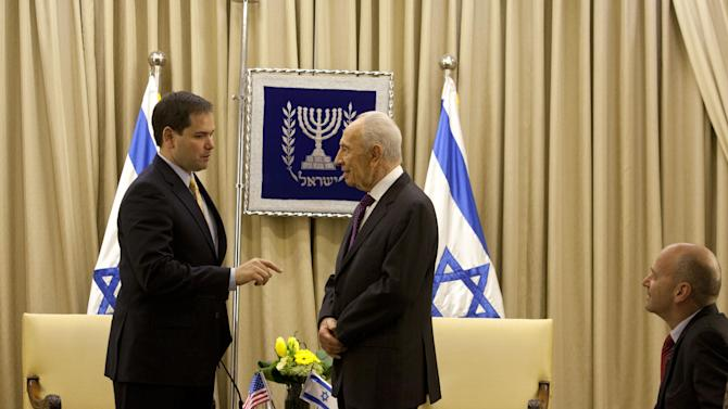 Israel's President Shimon Peres, center right, speaks with US Sen. Marco Rubio, R-Fla. left, during their meeting in the President's residence in Jerusalem, Wednesday, Feb. 20, 2013. Rubio is on a visit to the region. (AP Photo/Sebastian Scheiner)