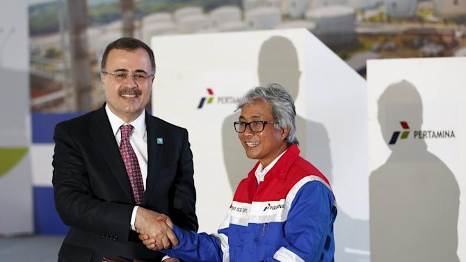 CEOs of Saudi Aramco and Indonesia's Pertamina shake hands in Cilicap