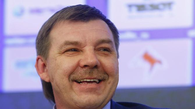 Oleg Znarok, new head coach of the Russian national hockey team smiles while answering a question during a news conference in Moscow, Russia, Friday March, 28, 2014. Oleg Znarok has been hired as Russia's new hockey coach, taking over a team that failed to win a medal at the Sochi Olympics