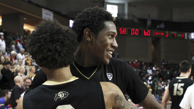 Colorado's Xavier Johnson, right, hugs teammate Askia Booker after they defeated Baylor 60-58 in an NCAA college basketball game at the Charleston Classic, Friday Nov. 16, 2012, in Charleston, S.C.  (AP Photo/Alice Keeney)