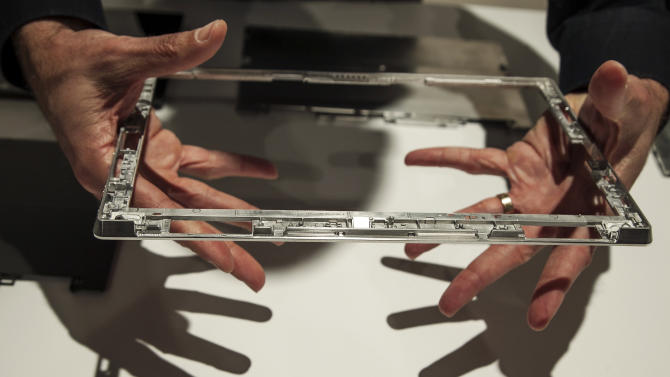 """The internal metal frame of the new Microsoft """"Surface,"""" a tablet computer to compete with Apple's iPad, is shown at Hollywood's Milk Studios in Los Angeles, Monday, June 18, 2012. The 9.3 millimeter thick tablet comes with a kickstand to hold it upright and keyboard that is part of the device's cover. It weighs under 1.5 pounds. (AP Photo/Damian Dovarganes)"""