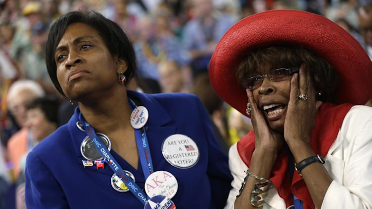 North Carolina delegate Ingrid Nurse, left, and Hiawatha Foster react as Rep. Emanuel Cleaver II of Missouri addresses the Democratic National Convention in Charlotte, N.C., on Wednesday, Sept. 5, 2012. (AP Photo/Charles Dharapak)