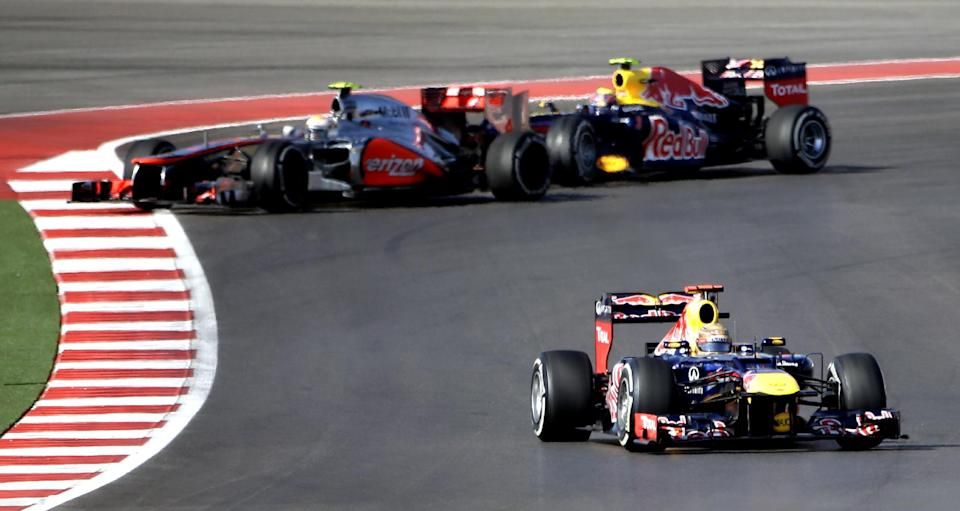 Red Bull driver Sebastian Vettel, right,  of Germany, steers his car during the Formula One U.S. Grand Prix auto race at the Circuit of the Americas Sunday, Nov. 18, 2012, in Austin, Texas. (AP Photo/David J. Phillip)