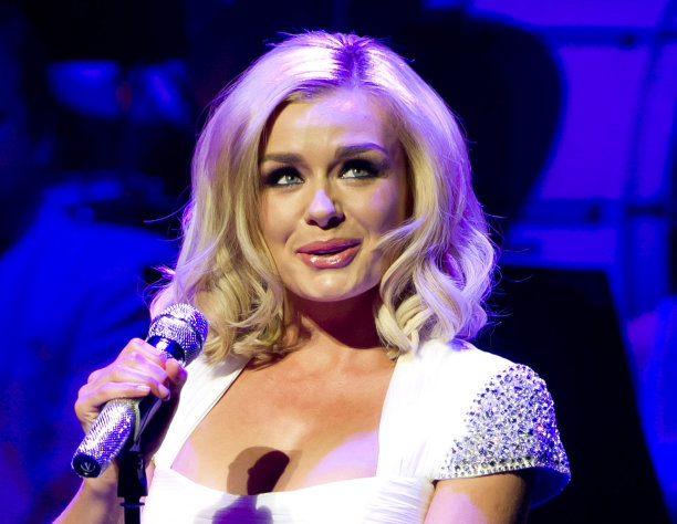 FILE - In this Jan. 7, 2012 file photo, British singer, Katherine Jenkins performs at the New Oxford Theatre, Oxford. Jenkins will be among the 12 celebrity contestants on the next season of the ABC dancing competition, premiering March 19. (AP Photo/Jonathan Short, file)
