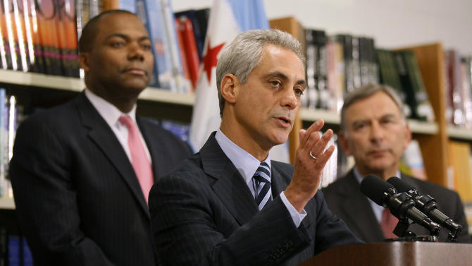 Chicago Mayor Rahm Emanuel, center, is flanked by Chicago Public Schools CEO Jean-Claud Brizard, left, and school board president David Vitale during a news conference after the teachers union House of Delegates voted to suspend their strike Tuesday, Sept. 18, 2012, in Chicago. The city's teachers agreed to return to the classroom after more than a week on the picket lines, ending a spiteful stalemate with Emanuel that put teacher evaluations and job security at the center of a national debate about the future of public education.  (AP Photo/Charles Rex Arbogast)