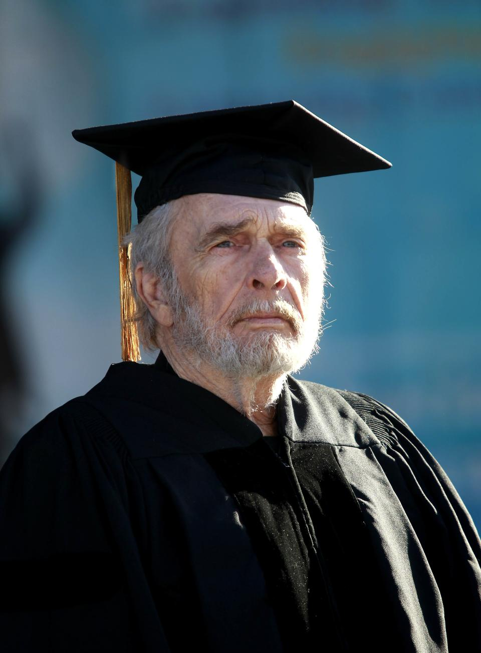 Country music legend Merle Haggard waits to receive an Honorary Doctorate at the 2013 Arts and Humanities Commencement ceremonies at California State University, Bakersfield on Friday June 14, 2013. (AP photo/The Bakersfield Californian, Felix Adamo)