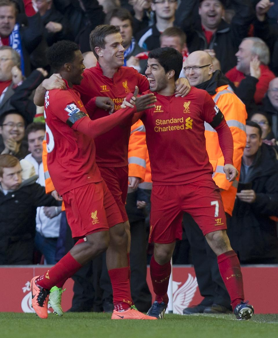 Liverpool's Luis Suarez, right, celebrates with teammates after scoring against Chelsea during their English Premier League soccer match at Anfield Stadium, Liverpool, England, Sunday April 21, 2013. (AP Photo/Jon Super)