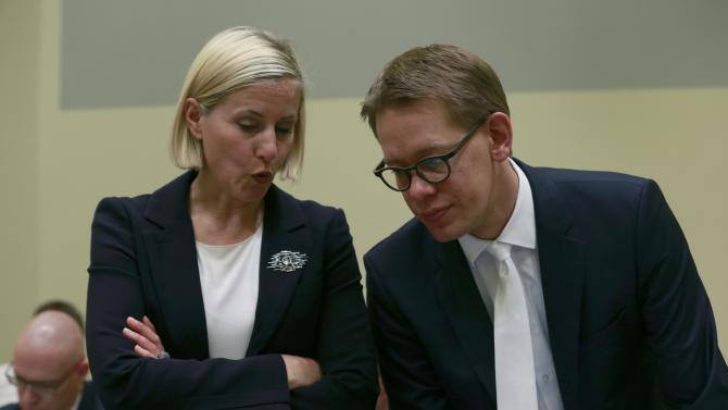 Lawyers Sturm and Heer of defendant Zschaepe wait for continuation of client's trial in Munich