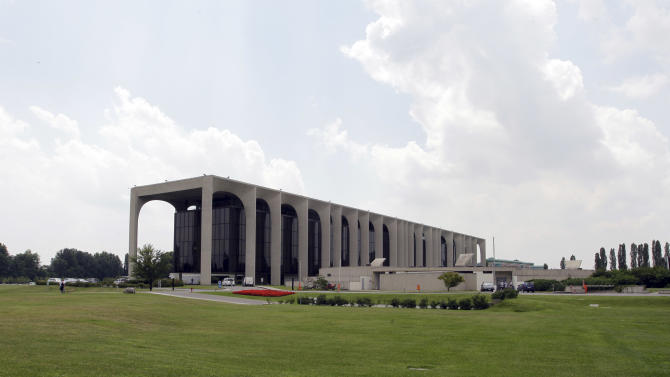 FILE - In this July 8, 2011 file photo, the headquarters for the Mondadori publishing grou, designed by Brazilian architect Oscar Niemeyer, stands in Milan, Italy.  According to a hospital spokeswoman on Wednesday, Dec. 5, 2012, famed Brazilian architect Oscar Niemeyer has died at age 104. (AP Photo/Luca Bruno, File)