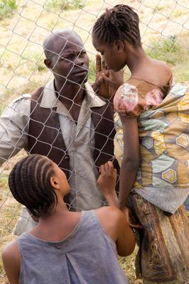 Beny Mabhena, Djimon Hounsou and Anoti Lokola in Warner Bros. Blood Diamond