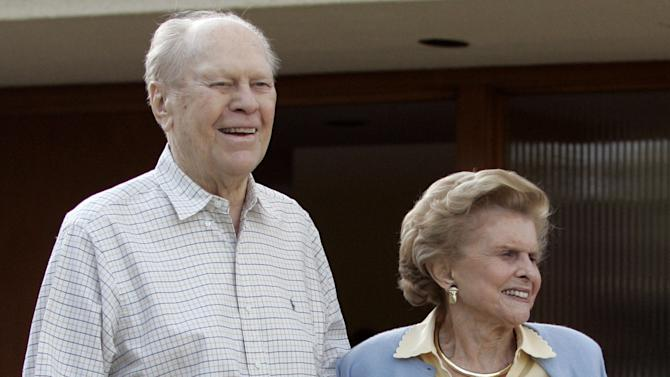 FILE - In this Sunday, April 23, 2006 file picture, former President Gerald Ford and former first lady Betty Ford smile from the front of their home in Rancho Mirage, Calif. as President Bush, not pictured, leaves after a visit. On Friday, July 8, 2011, a family friend said that Betty Ford had died at the age of 93. (AP Photo/Gerald Herbert)