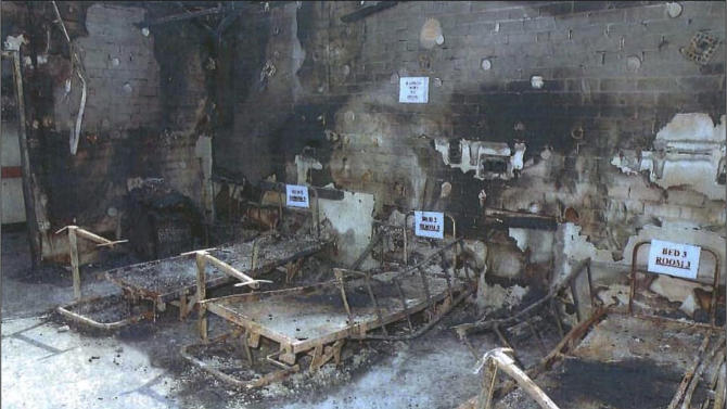 In this undated photo provided by the Office of the Director of Public Prosecutions (DPP) in Australia, evidence is labeled at the scene of a deadly nursing home fire in the Sydney suburb of Quakers Hill. A Sydney nurse was sentenced to life in prison on Thursday, Aug. 1, 2013, for setting two fires that engulfed the nursing home in 2011. (AP Photo/DPP ) EDITORIAL USE ONLY