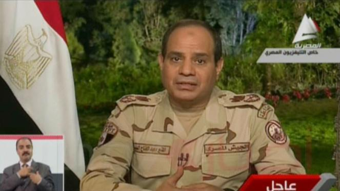 Image grab from Egyptian state television Al-Masriya on March 26, 2014 shows General Abdul Fatah Al-Sissi announcing resignation from military position to stand in the upcoming presidential elections during a televised address in Cairo