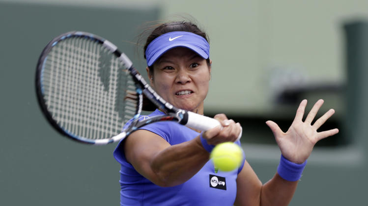 Li Na, of China,  returns to Garbine Muguruza, of Spain, during the Sony Open tennis tournament, Monday, March 25, 2013, in Key Biscayne, Fla.  Li Na won, 7-6 (6), 6-2.(AP Photo/Lynne Sladky)